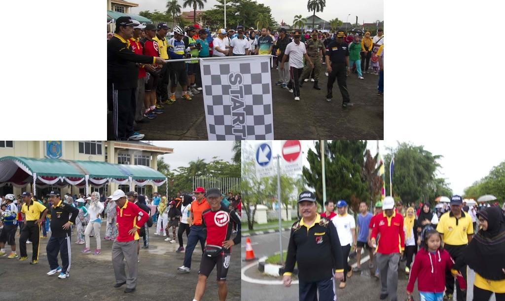 Hujan, Bupati dan Ketua DPRD Ikuti Jalan Sehat